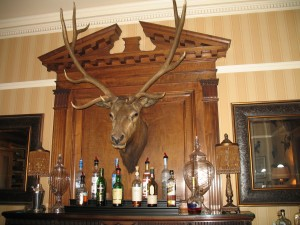 The masculine bar includes many taxidermied animals as decor.