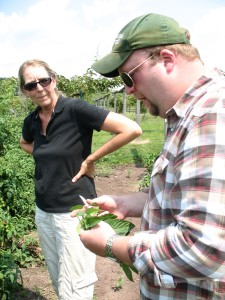 Kathy Glahn shows Chef Andy around the farm.