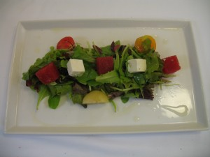 A salad with watermelon, feta and heirloom tomatoes.